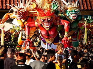 Tourists gather to look at Balinese Nyepi Day statues