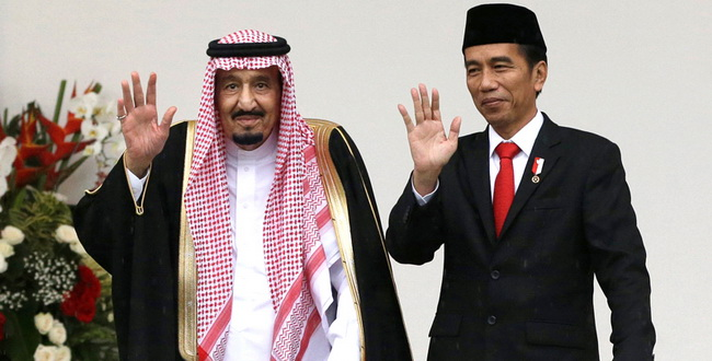Saudi King Salman, left, and Indonesian President Joko Widodo wave to the media during their meeting at the presidential palace in Bogor, West Java, Indonesia, Wednesday, March 1, 2017. Salman arrived in the world's largest Muslim nation on Wednesday as part of a multi-nation tour aimed at boosting economic ties with Asia. REUTERS/Achmad Ibrahim/Pool